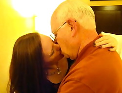 Young beautiful girl kisses with fat old guy